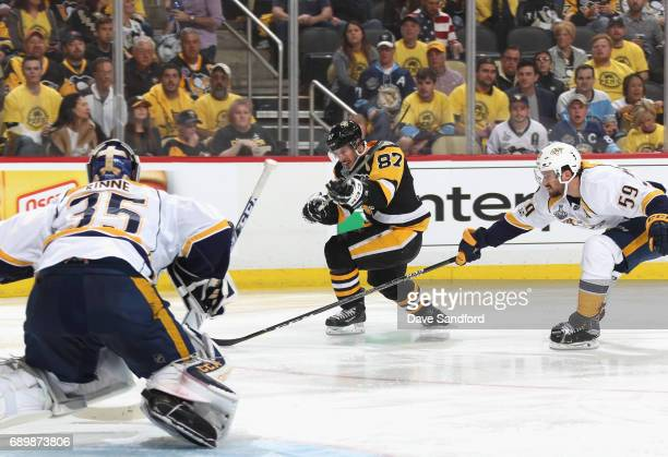 Sidney Crosby of the Pittsburgh Penguins hits a backhand shot that goes wide of goaltender Pekka Rinne of the Nashville Predators during the second...