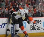 Sidney Crosby of the Pittsburgh Penguins hits Scott Hartnell of the Philadelphia Flyers at the Wells Fargo Center on October 16 2010 in Philadelphia...