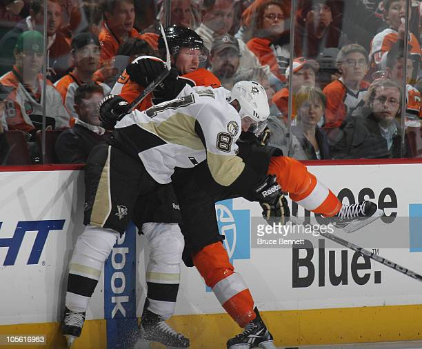 Sidney Crosby of the Pittsburgh Penguins hits Scott Hartnell of the Philadelphia Flyers at the Wells Fargo Center on October 16 2010 in Philadelphia...