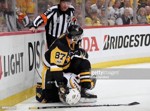 Sidney Crosby of the Pittsburgh Penguins holds PK Subban of the Nashville Predators down to the ice during the first period of Game Five of the 2017...