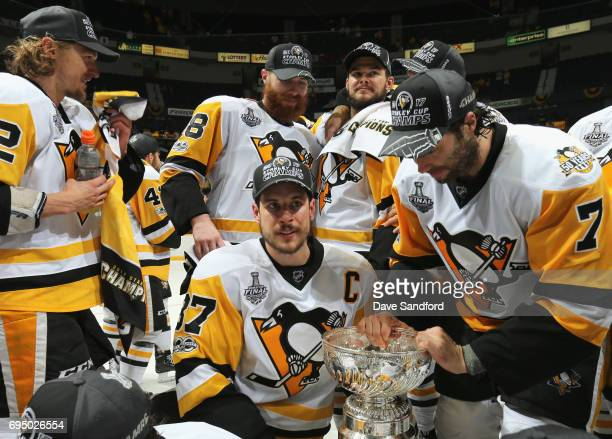 Sidney Crosby of the Pittsburgh Penguins holds the Stanley Cup after the Penguins defeated the Nashville Predators 20 to win the 2017 NHL Stanley Cup...