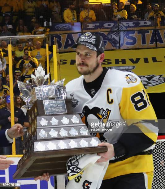 Sidney Crosby of the Pittsburgh Penguins is awarded the Conn Smythe trophy following the Cup clinching victory over the Nashville Predators in Game...