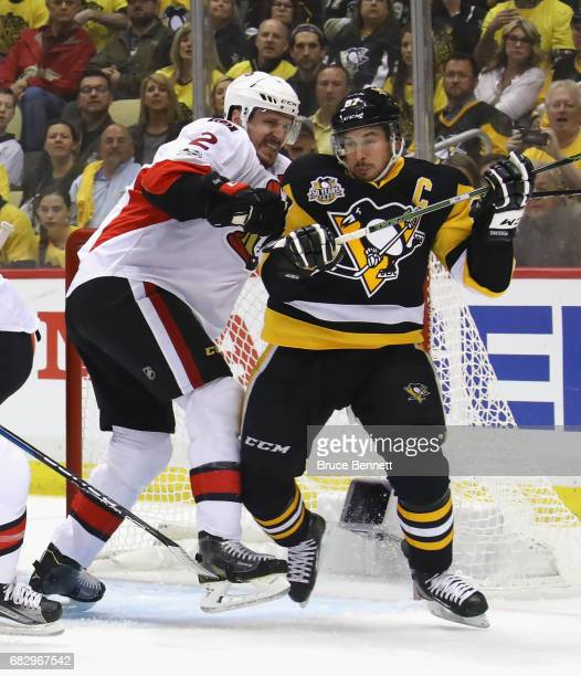 Sidney Crosby of the Pittsburgh Penguins is checked by Dion Phaneuf of the Ottawa Senators in Game One of the Eastern Conference Final during the...