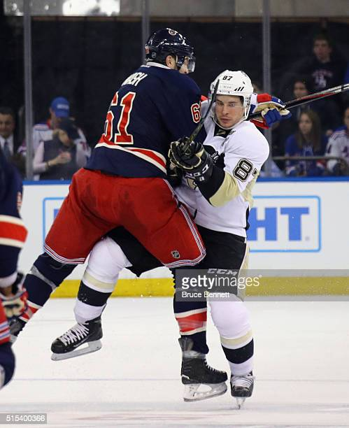 Sidney Crosby of the Pittsburgh Penguins is checked by Rick Nash of the New York Rangers during the second period at Madison Square Garden on March...