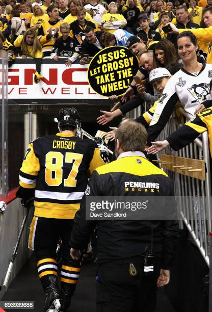 Sidney Crosby of the Pittsburgh Penguins is congratulated by fans as he leaves the ice after his team's 60 victory over the Nashville Predators in...
