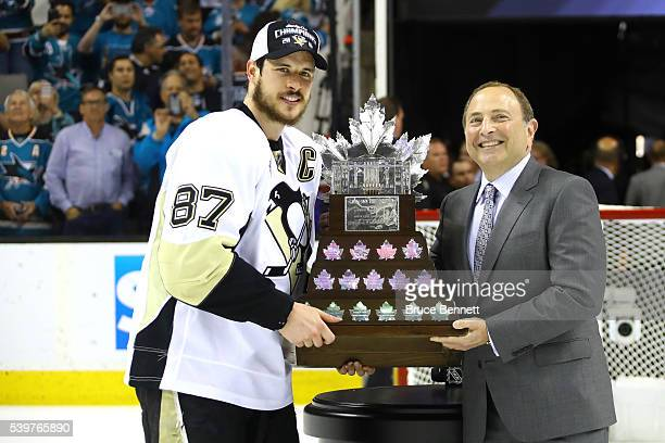 Sidney Crosby of the Pittsburgh Penguins is presented with the Conn Smythe Trophy by NHL Commissioner Gary Bettman after their 31 victory to win the...
