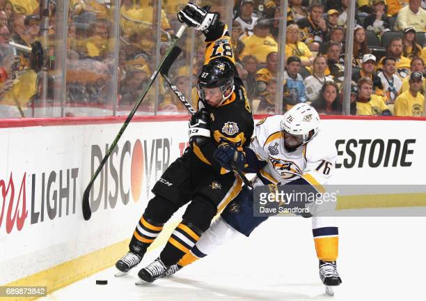 Sidney Crosby of the Pittsburgh Penguins is pressured by PK Subban of the Nashville Predators at the boards during the second period of Game One of...