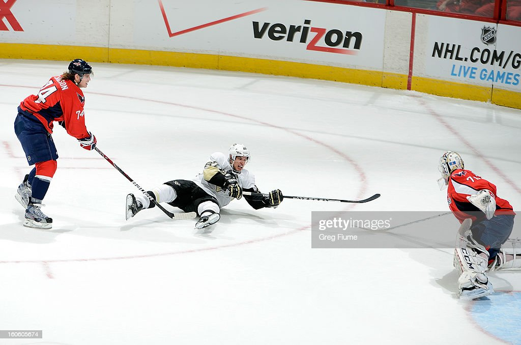 <a gi-track='captionPersonalityLinkClicked' href=/galleries/search?phrase=Sidney+Crosby&family=editorial&specificpeople=212781 ng-click='$event.stopPropagation()'>Sidney Crosby</a> #87 of the Pittsburgh Penguins is pulled down by John Carlson #74 of the Washington Capitals at the Verizon Center on February 3, 2013 in Washington, DC.