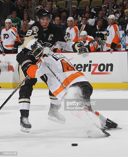 Sidney Crosby of the Pittsburgh Penguins is stopped by Kimmo Timonen of the Philadelphia Flyers at the Consol Energy Center on October 7 2010 in...