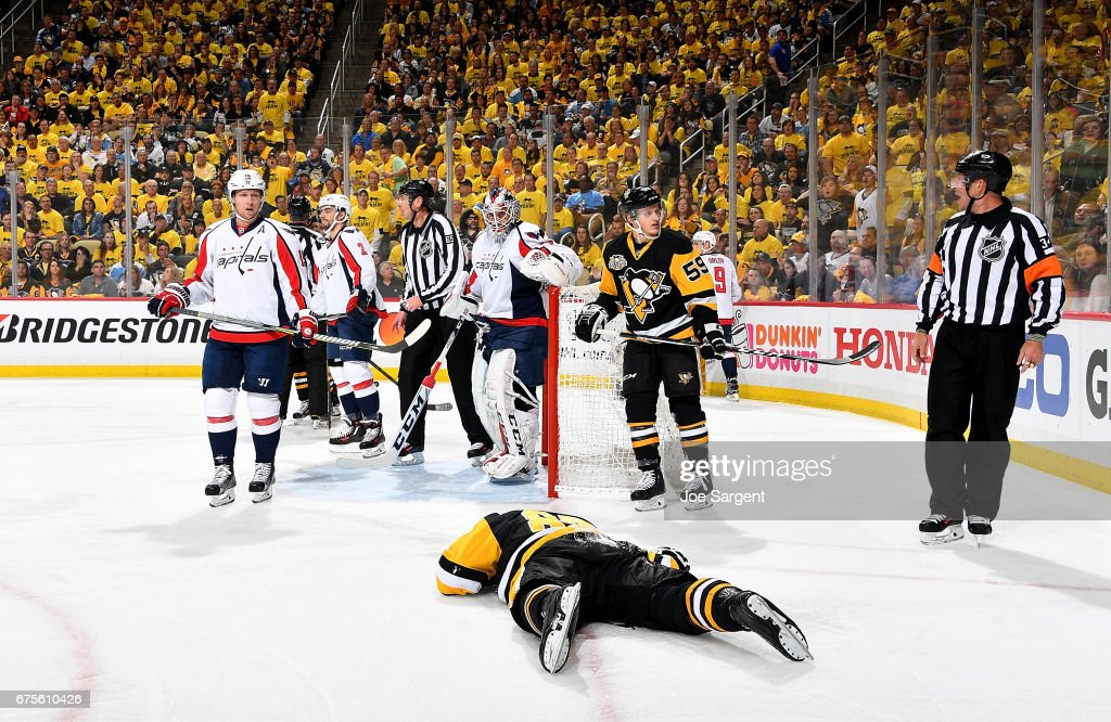 Sidney Crosby #87 of the Pittsburgh Penguins lays on the ice injured after being cross checked in the head during the first period against the Washington Capitals in Game Three of the Eastern Conference Second Round during the 2017 NHL Stanley Cup Playoffs at PPG Paints Arena on May 1, 2017 in Pittsburgh, Pennsylvania.