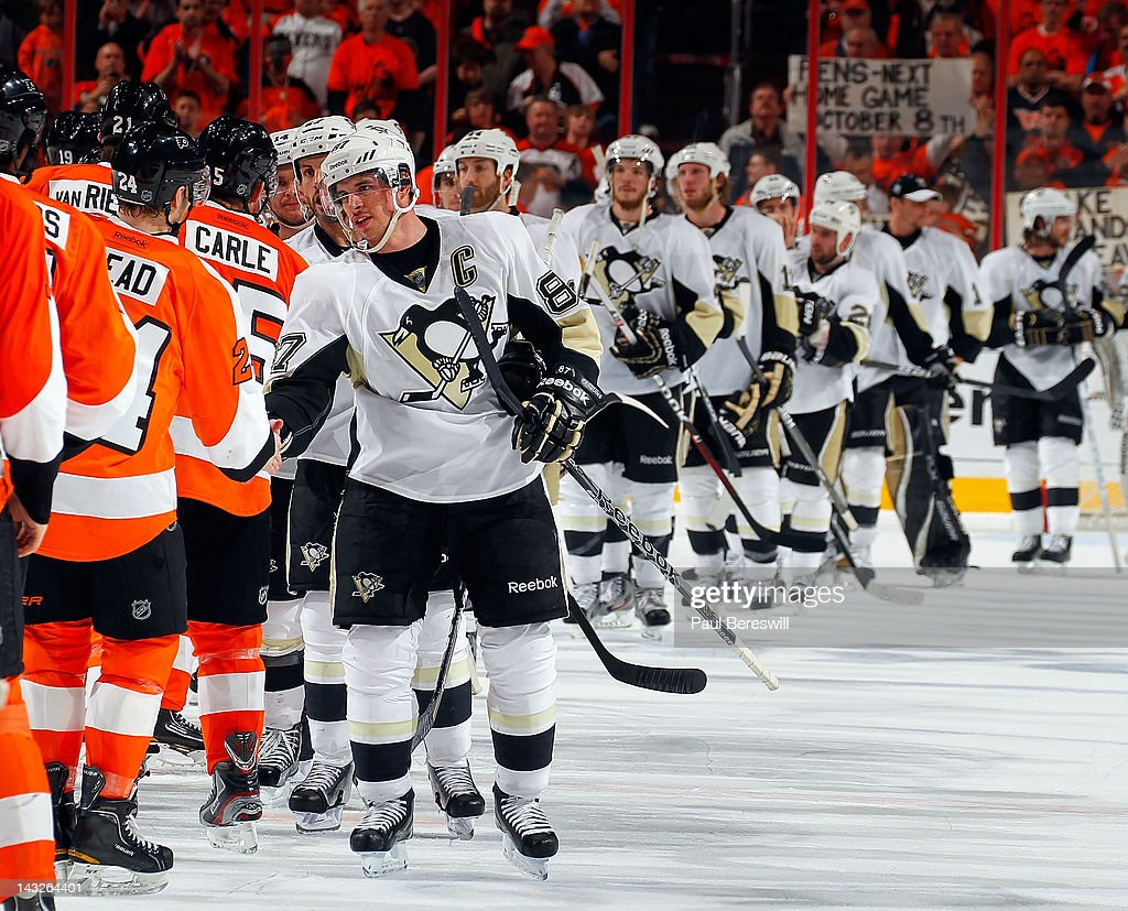 Sidney Crosby #87 of the Pittsburgh Penguins leads the line of his team as they give the traditional handshake to memebers of the Philadelphia Flyers after the Flyers defeated the Penguins 5-1 in Game Six of the Eastern Conference Quarterfinals to eliminate the Pittsburgh Penguins during the 2012 NHL Stanley Cup Playoffs at Wells Fargo Center on April 22, 2012 in Philadelphia, Pennsylvania.