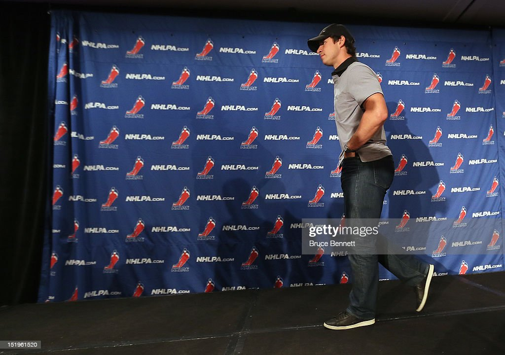 <a gi-track='captionPersonalityLinkClicked' href=/galleries/search?phrase=Sidney+Crosby&family=editorial&specificpeople=212781 ng-click='$event.stopPropagation()'>Sidney Crosby</a> of the Pittsburgh Penguins leaves the podium after meeting with the media following the NHLPA meeting at Marriott Marquis Times Square on September 13, 2012 in New York City.