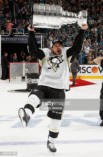 Sidney Crosby of the Pittsburgh Penguins lifts the Stanley Cup after his team won Game 6 of the 2016 NHL Stanley Cup Final over the San Jose Sharks...