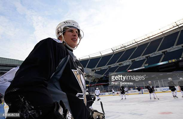 Sidney Crosby of the Pittsburgh Penguins looks on during the 2014 NHL Stadium Series practice day at Soldier Field on February 28 2014 in Chicago...