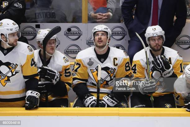 Sidney Crosby of the Pittsburgh Penguins looks on from the bench during the third period against the Nashville Predators in Game Three of the 2017...