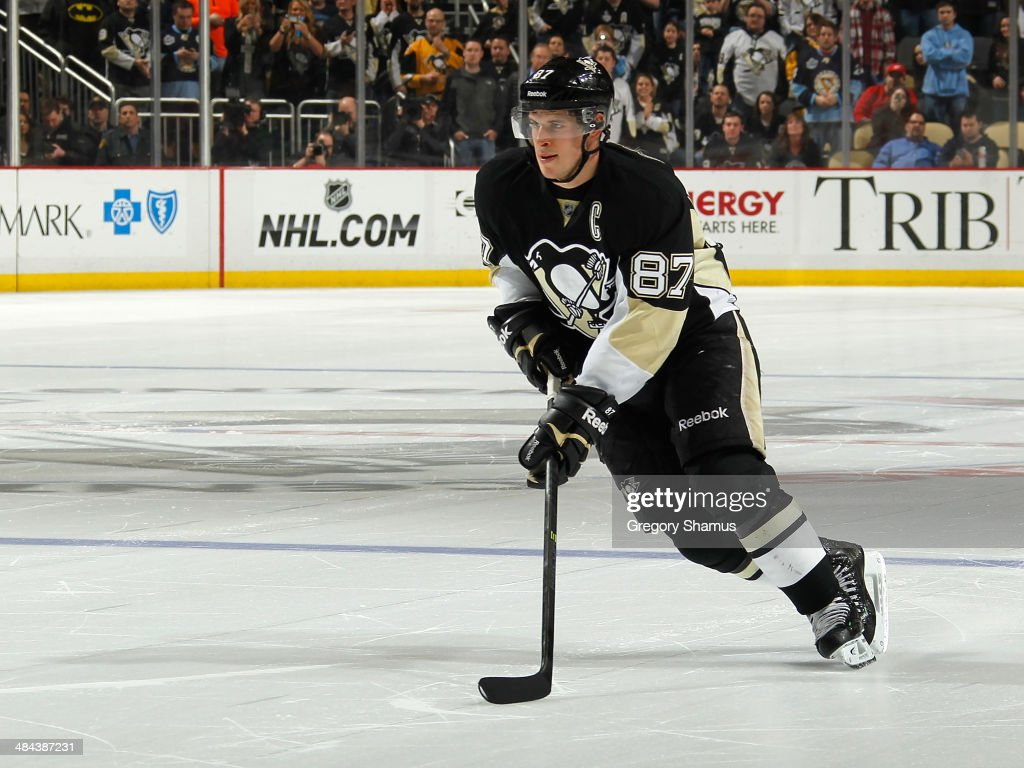 <a gi-track='captionPersonalityLinkClicked' href=/galleries/search?phrase=Sidney+Crosby&family=editorial&specificpeople=212781 ng-click='$event.stopPropagation()'>Sidney Crosby</a> #87 of the Pittsburgh Penguins moves the puck against the Detroit Red Wings on April 9, 2014 at Consol Energy Center in Pittsburgh, Pennsylvania.