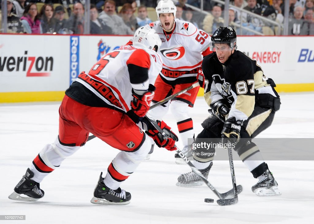 <a gi-track='captionPersonalityLinkClicked' href=/galleries/search?phrase=Sidney+Crosby&family=editorial&specificpeople=212781 ng-click='$event.stopPropagation()'>Sidney Crosby</a> #87 of the Pittsburgh Penguins moves the puck between the defense of <a gi-track='captionPersonalityLinkClicked' href=/galleries/search?phrase=Tim+Gleason&family=editorial&specificpeople=211575 ng-click='$event.stopPropagation()'>Tim Gleason</a> #6 and Chad Larose #59 of the Carolina Hurricanes on November 19, 2010 at Consol Energy Center in Pittsburgh, Pennsylvania. Pittsburgh won the game 5-4 in a shootout.