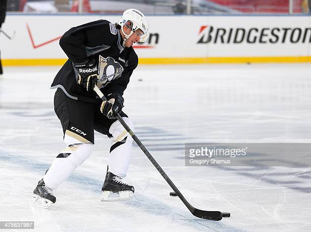 Sidney Crosby of the Pittsburgh Penguins moves the puck during the 2014 NHL Stadium Series practice day on February 28 2014 at Soldier Field in...
