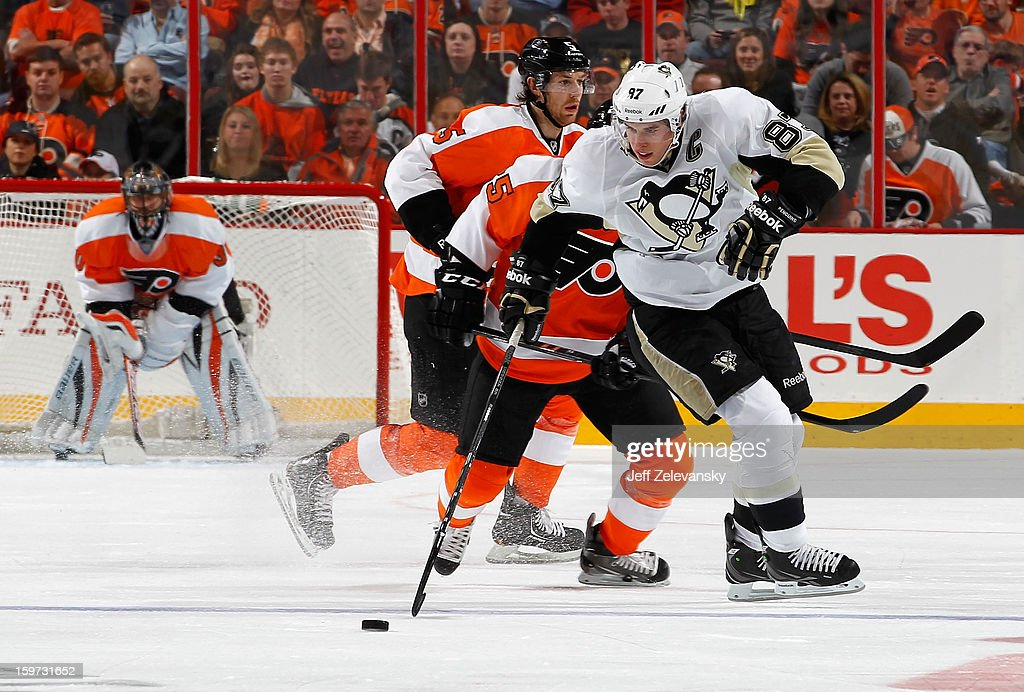 Sidney Crosby #87 of the Pittsburgh Penguins moves the puck in front of Maxime Talbot #25 of the Philadelphia Flyers at Wells Fargo Center on January 19, 2013 in Philadelphia, Pennsylvania.