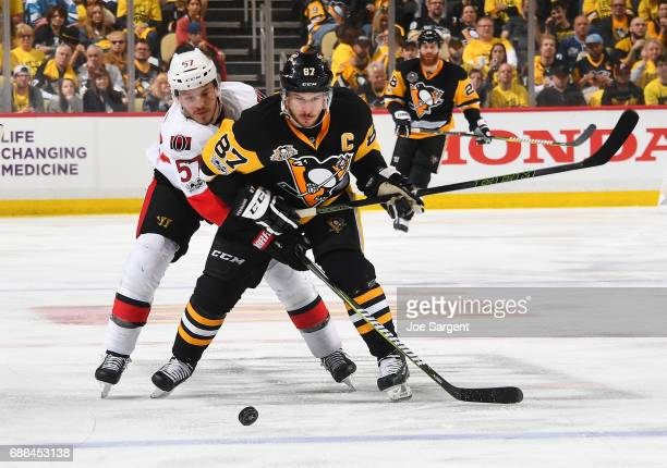 Sidney Crosby of the Pittsburgh Penguins moves the puck in front of Tommy Wingels of the Ottawa Senators in Game Five of the Eastern Conference Final...