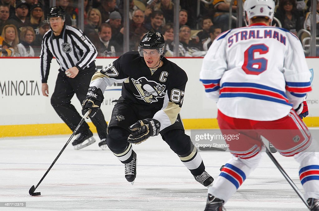 Sidney Crosby #87 of the Pittsburgh Penguins moves the puck up ice in front of Anton Stralman #6 of the New York Rangers on February 7, 2014 at Consol Energy Center in Pittsburgh, Pennsylvania.