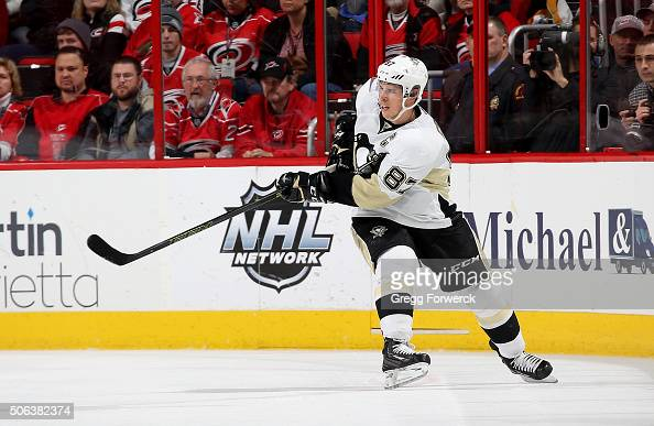 Sidney Crosby of the Pittsburgh Penguins passes the puck during an NHL game against the Carolina Hurricanes at PNC Arena on January 12 2016 in...