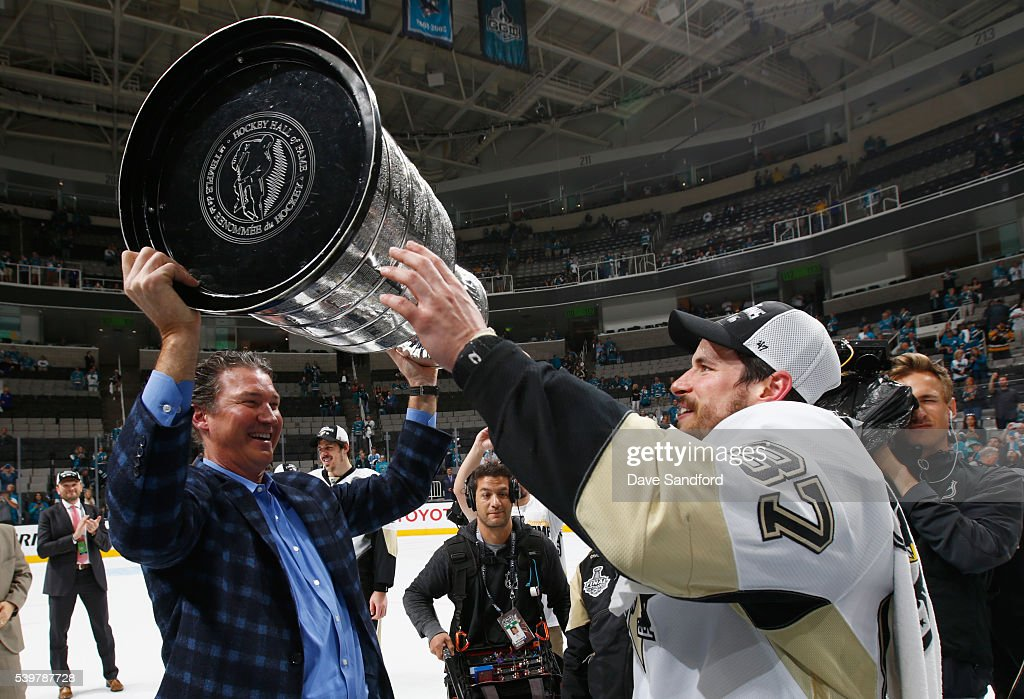 Sidney Crosby #87 of the Pittsburgh Penguins passes the Stanley Cup to co-owner and chairman Mario Lemieux after the Penguins won Game 6 of the 2016 NHL Stanley Cup Final over the San Jose Sharks at SAP Center on June 12, 2016 in San Jose, California. The Penguins won the game 3-1 and the series 4-2.