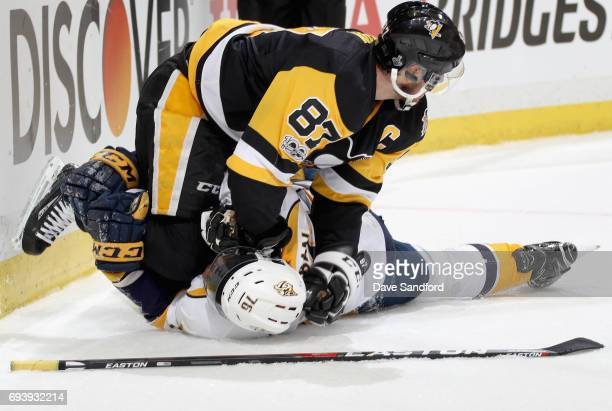 Sidney Crosby of the Pittsburgh Penguins pins PK Subban of the Nashville Predators down to the ice during the first period of Game Five of the 2017...