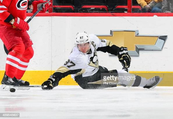 Sidney Crosby of the Pittsburgh Penguins plays the puck from the ice during an NHL game against the Carolina Hurricanes on December 27 2013 at PNC...