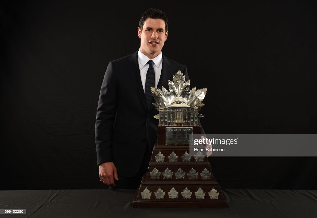 Sidney Crosby of the Pittsburgh Penguins poses for a portrait with the Conn Smythe Trophy at the 2017 NHL Awards at T-Mobile Arena on June 21, 2017 in Las Vegas, Nevada.