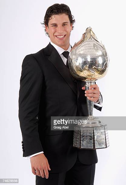 Sidney Crosby of the Pittsburgh Penguins poses for a portrait backstage with the Hart Memorial Trophy during the 2007 NHL Awards at the Elgin Theatre...