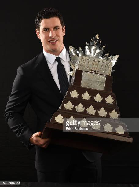 Sidney Crosby of the Pittsburgh Penguins poses for a portrait with the Conn Smythe Trophy at the 2017 NHL Awards at TMobile Arena on June 21 2017 in...
