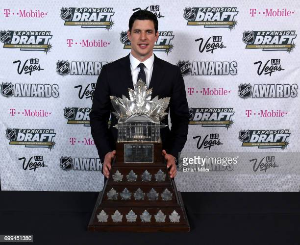 Sidney Crosby of the Pittsburgh Penguins poses with the Conn Smythe Trophy as the NHL's playoff MVP during the 2017 NHL Awards and Expansion Draft at...