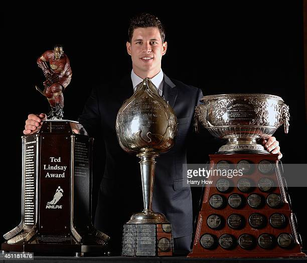 Sidney Crosby of the Pittsburgh Penguins poses with the Ted Lindsay Award the Hart Memorial Trophy and the Art Ross Trophy during the 2014 NHL Awards...