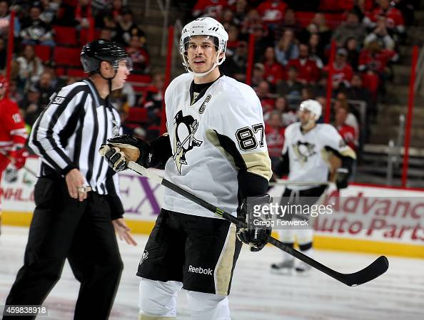 Sidney Crosby of the Pittsburgh Penguins prepares for a face off during their NHL game against the Carollina Hurricanes at PNC Arena on November 29...