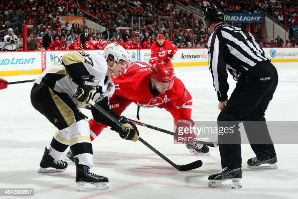 Sidney Crosby of the Pittsburgh Penguins prepares for a faceoff against Jordan Staal of the Carolina Hurricanes during an NHL game on December 27...