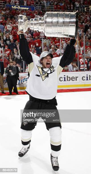 Sidney Crosby of the Pittsburgh Penguins raises the Stanley Cup after defeating the Detroit Red Wings in Game Seven of the 2009 Stanley Cup Finals at...