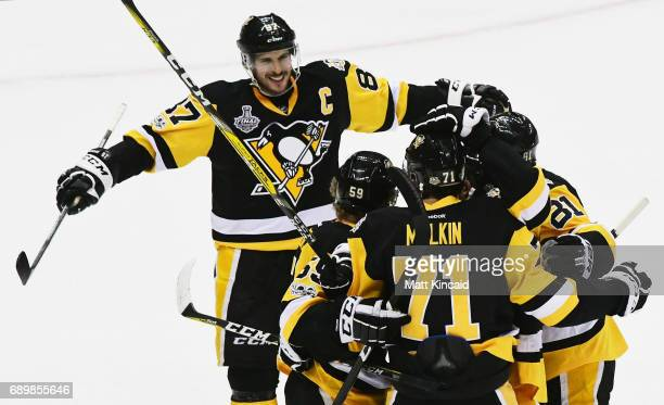 Sidney Crosby of the Pittsburgh Penguins reacts after a goal by Evgeni Malkin during the first period in Game One of the 2017 NHL Stanley Cup Final...