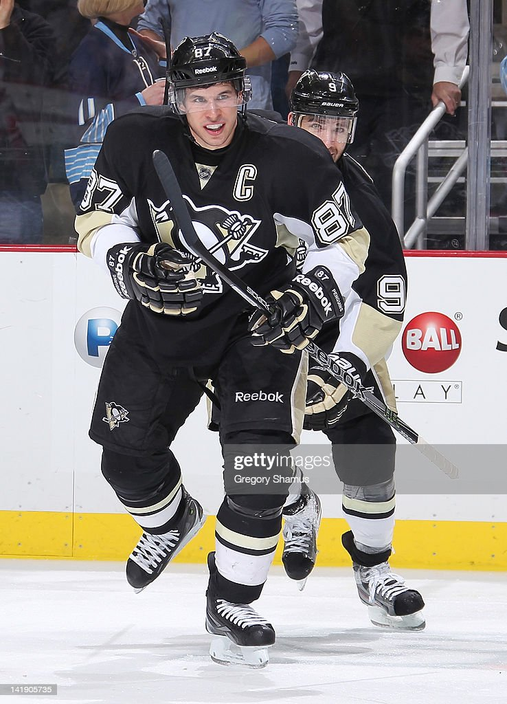 <a gi-track='captionPersonalityLinkClicked' href=/galleries/search?phrase=Sidney+Crosby&family=editorial&specificpeople=212781 ng-click='$event.stopPropagation()'>Sidney Crosby</a> #87 of the Pittsburgh Penguins reacts after his goal during the third period against the New Jersey Devils on March 25, 2012 at Consol Energy Center in Pittsburgh, Pennsylvania. Pittsburgh won the game 5-2.