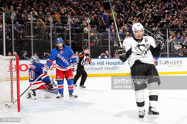 Sidney Crosby of the Pittsburgh Penguins reacts after scoring the game winning goal in overtime against Henrik Lundqvist of the New York Rangers at...