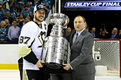 Sidney Crosby of the Pittsburgh Penguins recieves the Stanley Cup from NHL Commissioner Gary Bettman after their Game Six victory over the San Jose...