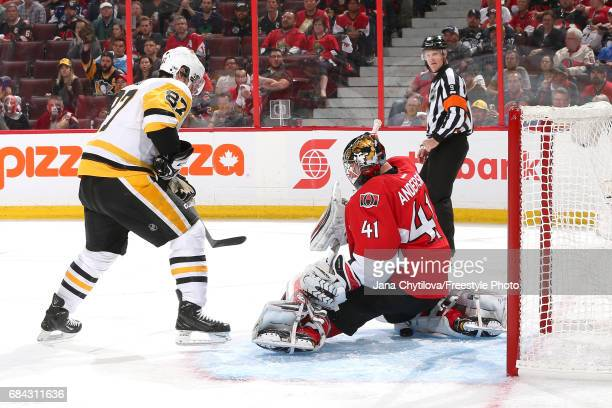 Sidney Crosby of the Pittsburgh Penguins scores a goal against Craig Anderson of the Ottawa Senators during the third period in Game Three of the...