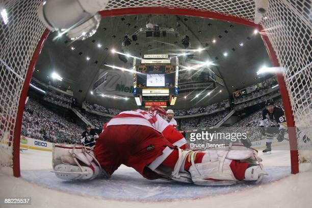 Sidney Crosby of the Pittsburgh Penguins scores a goal in the second period against goaltender Chris Osgood the Detroit Red Wings during Game Four of...