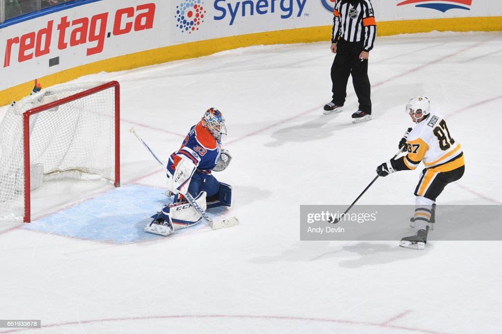 Sidney Crosby #87 of the Pittsburgh Penguins scores a goal in the shoot out on Cam Talbot #33 of the Edmonton Oilers on March 10, 2017 at Rogers Place in Edmonton, Alberta, Canada.