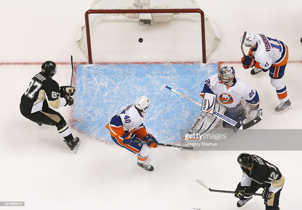 <a gi-track='captionPersonalityLinkClicked' href=/galleries/search?phrase=Sidney+Crosby&family=editorial&specificpeople=212781 ng-click='$event.stopPropagation()'>Sidney Crosby</a> #87 of the Pittsburgh Penguins scores his first goal of the game on goalie <a gi-track='captionPersonalityLinkClicked' href=/galleries/search?phrase=Evgeni+Nabokov&family=editorial&specificpeople=171380 ng-click='$event.stopPropagation()'>Evgeni Nabokov</a> #20 and <a gi-track='captionPersonalityLinkClicked' href=/galleries/search?phrase=Michael+Grabner&family=editorial&specificpeople=537955 ng-click='$event.stopPropagation()'>Michael Grabner</a> #40 of the New York Islanders in Game Two of the Eastern Conference Quarterfinals during the 2013 NHL Stanley Cup Playoffs at Consol Energy Center on May 3, 2013 in Pittsburgh, Pennsylvania.