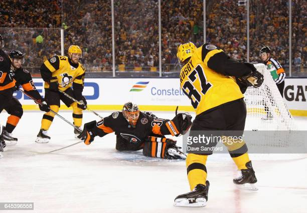 Sidney Crosby of the Pittsburgh Penguins scores on goaltender Michal Neuvirth of the Philadelphia Flyers during the first period of the 2017 Coors...