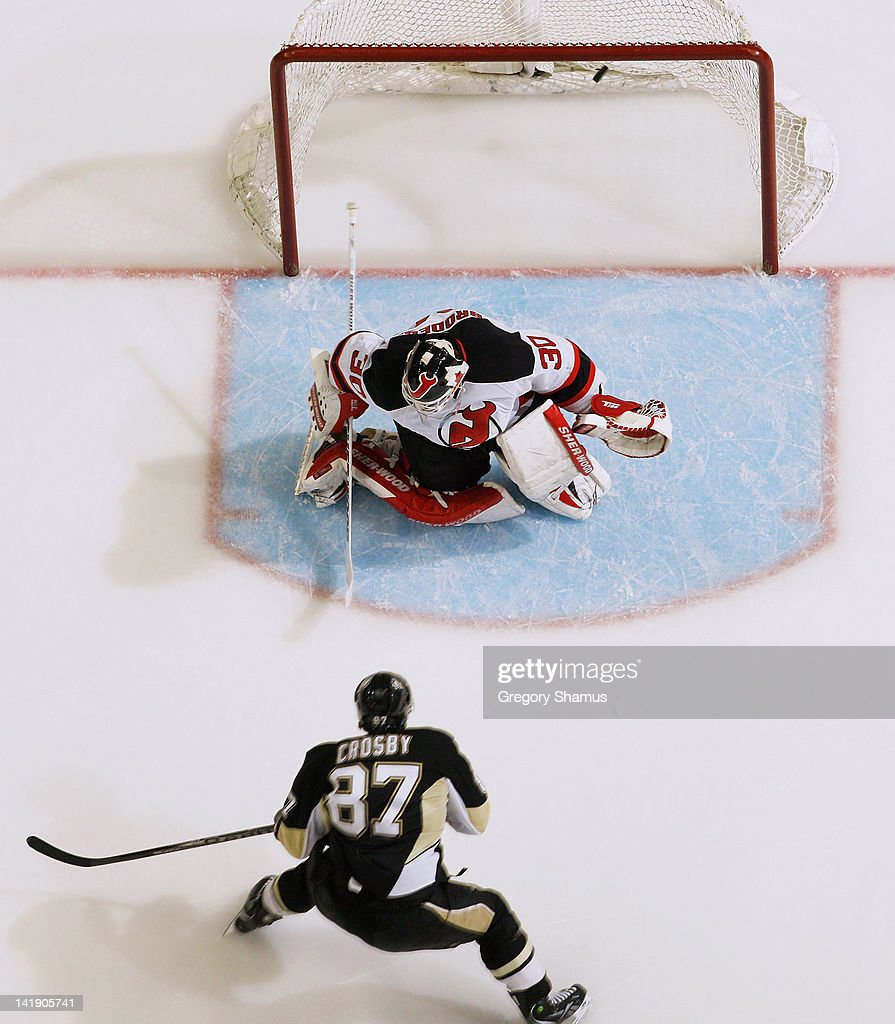 <a gi-track='captionPersonalityLinkClicked' href=/galleries/search?phrase=Sidney+Crosby&family=editorial&specificpeople=212781 ng-click='$event.stopPropagation()'>Sidney Crosby</a> #87 of the Pittsburgh Penguins scores on <a gi-track='captionPersonalityLinkClicked' href=/galleries/search?phrase=Martin+Brodeur&family=editorial&specificpeople=201594 ng-click='$event.stopPropagation()'>Martin Brodeur</a> #30 of the New Jersey Devils on March 25, 2012 at Consol Energy Center in Pittsburgh, Pennsylvania. Pittsburgh won the game 5-2.