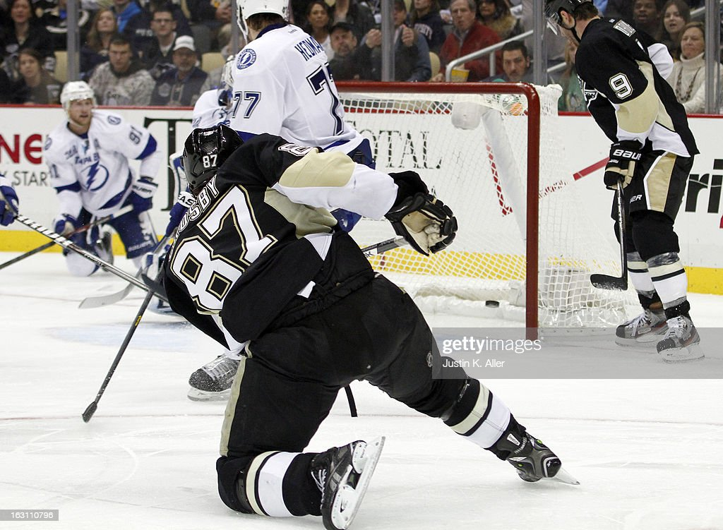 Sidney Crosby #87 of the Pittsburgh Penguins scores past Anders Lindback #39 of the Tampa Bay Lightning in the third period during the game at Consol Energy Center on March 4, 2013 in Pittsburgh, Pennsylvania. The Penguins defeated the Lightning 4-3.