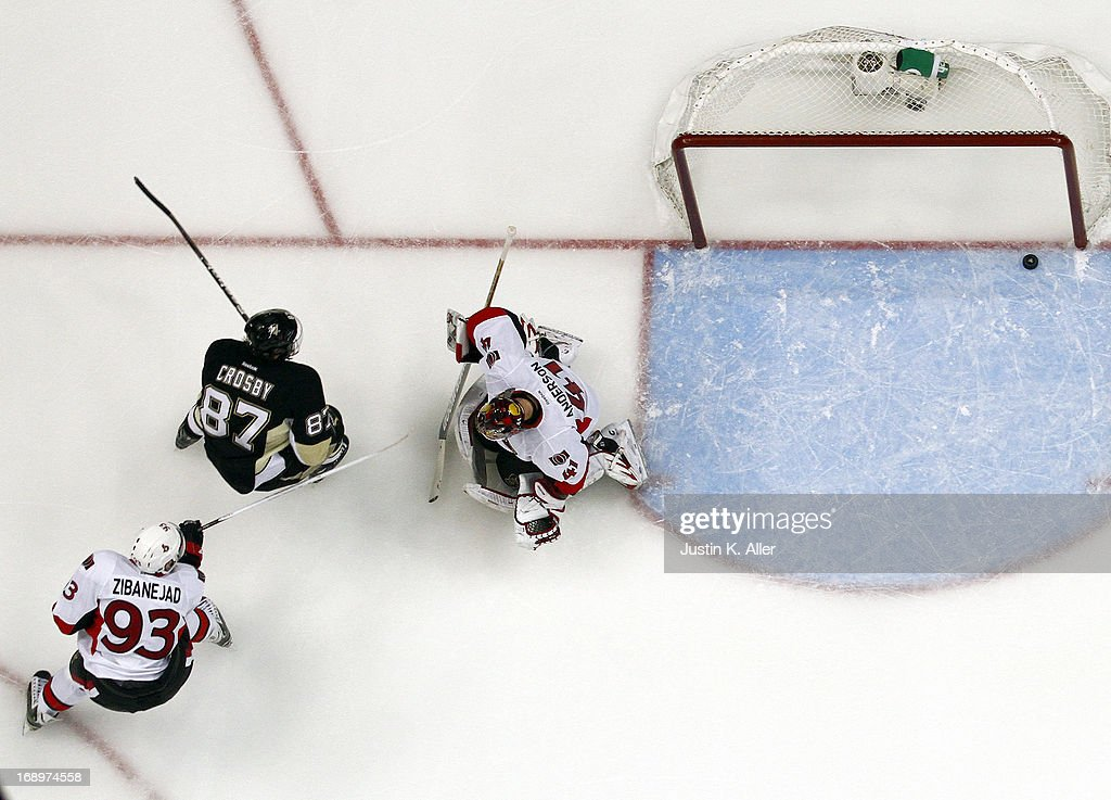 <a gi-track='captionPersonalityLinkClicked' href=/galleries/search?phrase=Sidney+Crosby&family=editorial&specificpeople=212781 ng-click='$event.stopPropagation()'>Sidney Crosby</a> #87 of the Pittsburgh Penguins scores past <a gi-track='captionPersonalityLinkClicked' href=/galleries/search?phrase=Craig+Anderson&family=editorial&specificpeople=211238 ng-click='$event.stopPropagation()'>Craig Anderson</a> #41 of the Ottawa Senators in the first period in Game Two of the Eastern Conference Semifinals during the 2013 NHL Stanley Cup Playoffs at Consol Energy Center on May 17, 2013 in Pittsburgh, Pennsylvania. The Penguins defeated the Senators 4-3.