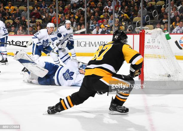 Sidney Crosby of the Pittsburgh Penguins scores past Frederik Andersen of the Toronto Maple Leafs during the third period at PPG Paints Arena on...